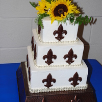 Chocolate Fleur De Lis   White Buttercream with Chocolate Fleur de Lis with Sunflower topper