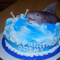Shark Buttercream waves with fondant/gumpaste shark and swimmer.