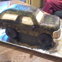 Camo Ford Bronco Made this cake for my husbands birthday. WASC cake covered in fondant. I used a sponge with brown and green gel color and dabbed the...