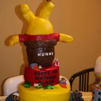 Winnie The Pooh Winnie the Pooh cake for a cousin, inspired by another one I found on the site. Bottom 2 layers are covered in fondant, with fondant/...