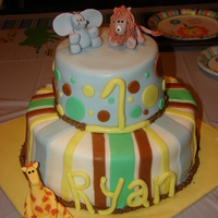 "1St Birthday The entire cake is covered in MMF. The animals are made from gumpaste. ""1"" and ""Ryan"" are made from MMF. There are alot..."