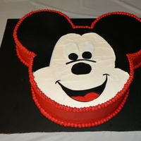 "Mickey Mouse Cake I made this Mickey Mouse cake for my son's 2nd birthday party. The mickey face is a 12"" round chocolate cake with buttercream..."