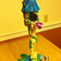 Rapunzel Tower Cake  A chocolate cake covered in BC and then fondant. Many accents gum paste, figurines plastic. Tower is PVC pipe bolted to sturdy board. Tower...