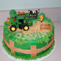 Tractor Cake This is a vanilla cake, covered in fondant with gumpaste accents, crushed cookie for dirt and plastic animals/fence. Made this for a...
