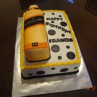 1317011624.jpg 9x13 cake with a another cake made to carve out the bottle. Edible image on bottle.