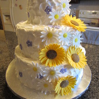 "Rustic Sunflowers, Daisies And Small Purple Blossoms 12"", 10"" and 6"" Vanilla cakes. Flowers are made with homemade marshmallow fondant. A few weeks ago I purchased Tylose online..."