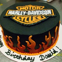 Harley Cake   9 inch chocolate cake with butter cream frosting and frozen buttercream transfer. Flames were fondant