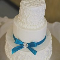 Daniel And Jenny *Buttercream with piping and satin ribbon