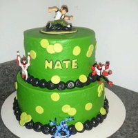 Ben 10 Customer sent me a picture similar to this cake and asked me to recreate it. Not sure who the original was by. Buttercream with fondant...