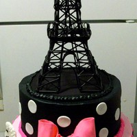 Paris Buttercream iced vanilla cake 8& 10 inch rounds with fondant and gumpaste detail work. Metal tower purchased by client