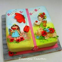Fairy Book Cake For a little girl who loves fairies!Fairies made out of fondant and painted and dust the background :-)