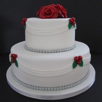 Classic White Wedding Cake Wedding cake covered with fondant, decorated with marzipan roses, simple and classic