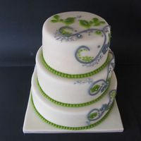 White Wedding Cake With Silver/lime Decoration This was more work than I thought, because there are also 3 separate cakes to complete the numbers of guests for this wedding. But I love...