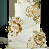 Wedding Cake With Gold Accents Bride requested a cake with flowers, ribbons, and some bling. Cake sizes are 12, 10, 8, 6, and 4 1/2 inch. There were also two cutting...