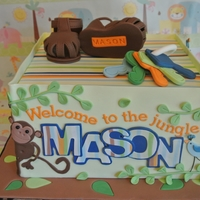 Jungle Baby Shower Cake Cake fashioned after baby's bedding. Shoes and teething ring fondant with tylose added. Cake wrapped in modeling chocolate. 9 inch...
