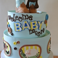Country Farm Animal Baby Shower Cake inspired by mother-to-be's pictures for the nursery. Animal scenes hand cut from modeling chocolate. Cake covered in modeling...