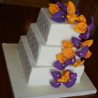 Calla Cascade  Three tier (6-8-10) square cake. White chocolate and chocolate cake with white chocolate buttercream filling and white chocolate ganache....