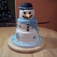 Snowman Cake three tiers 10-8-6 fondant covered with fondant accents. I loved making this cake!