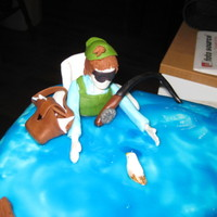 "Enjoying Life! this was so much fun! chocolate mud cake with chocolate ganache filling everything is made out of fondant the ""lake"" is homemade..."