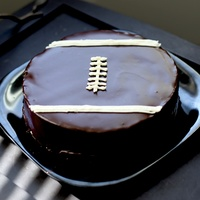 Flourless Chocolate Football Cake Flourless Chocolate Football Cake. Buttercream accents.