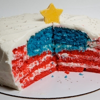 "Flag Cake Tried to duplicate ""themaytrix""'s hidden flag cake. Cake turned out to have too much crumb. Think I'll try pound cake..."