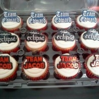 1321774467.jpg Vanilla Cupcakes w/bc frosting topped w/Team Jacob, Twilight and Team Edward rings