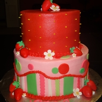 Strawberry Shortcake 8in+6in frosted in buttercream with fondant accents.