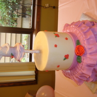 Angelina Ballerina Birthday Cake Angelina Ballerina is gumpaste. Top tier is buttercream and fondant flowers and bottom tier is gumpaste and tylose powder.