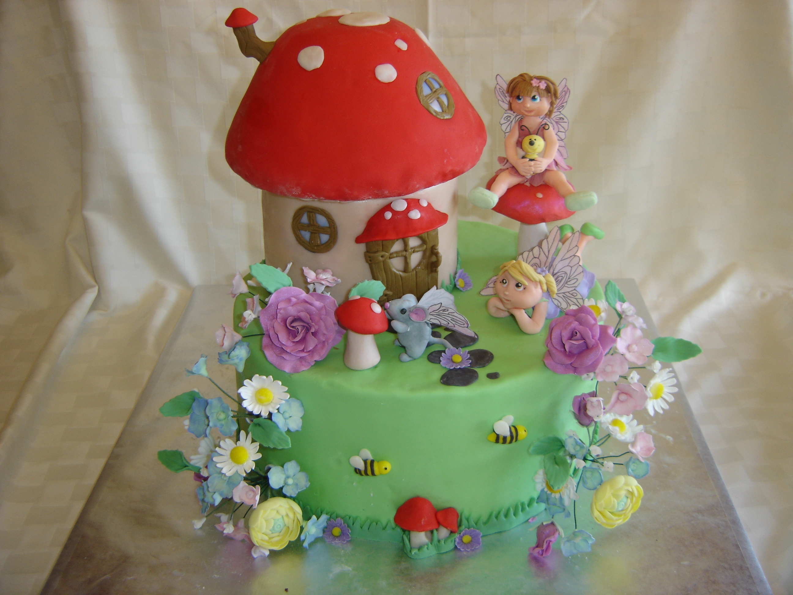 Fairy House Birthday Cake Birthday cake for my daughter...a peek at fairies in their home! House and base are all cake and fondant. Fairies, toadstools and flowers...