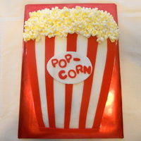 Popcorn Cake I made this for the Spring Carnival's cake walk at my daughter's school. Vanilla cake iced in BC with red fondant stripes and...