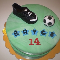 Bryces Soccer Cake Triple Choc Fudge with Choc ganache filling. All fondant - had fun practicing marbleizing green fondant and making the soccer cleats and...