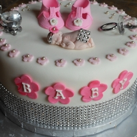 Vanessas Bling Baby Girl Shower Cake This is an two layers of orange cake, one layer lemon with raspberry filling. Vanessa is from NY and loves her bling. Hope she likes it.
