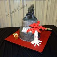 Game Of Thrones Grooms Cake Game of Thrones themed grooms cake. Buttercream iced cake with fondant accents. The Iron Throne topper is a resin figurine.