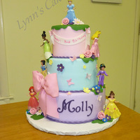 Disney Princess Birthday Cake Buttercream Iced Birthday Cake With Fondant Accents And Disney Princess Toy Figures Disney Princess Birthday Cake. Buttercream iced birthday cake with fondant accents and Disney princess toy figures.