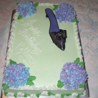 She's One Of A Kind! Chocolate cake with raspberry filling, buttercream icing and hydrangeas with fondant shoe