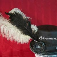 Stevie's Hat Fondant covered Almond cake with gumpaste details. Feathers are real - in a posy pick.