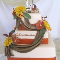 Fall Wedding Cake Butter-vanilla wedding cake with fondant frosting and drapes, and hand-crafted gumpaste sprays of spider mums, wild roses, and stephanotis...