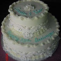 Anniversary Buttermilk cake, dark chocolate ganache filling frosted with almond buttercream.
