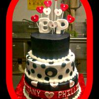 The Engagement Cake   Triple tier red velvet cake with cream cheese buttercream, fondant accents.