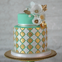 Gold And Mint With Wafer Paper Flowers This cake is made for a bridal shower. The flowers are made out wafer paper.