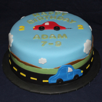 My Car Loving 2 Year Old My little boy is turning 2!!! =) And he LOVES cars! It's chocolate cake, buttercream, and MFF. All dairy free. Thanks for looking!!