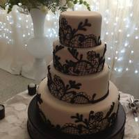 Black And White   The customer sent me a picture of a 2 tier cake with this beautiful design, don't know the cake designer to give credit.