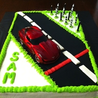 Race Car Cake simple design. Sheet cake iced with buttercream with fondant road and added a plastic race car.