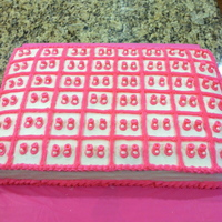 Baby Bootie Sheet Cake Simple large sheet cake iced with buttercream.Measured and marked off individual cake squares then added a pair of pink baby booty shaped...