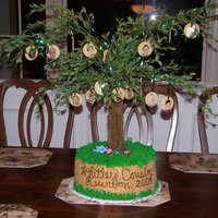 Family Reunion Cake for family reunion. Cookies hanging on tree with faces of each person attending the reunion.