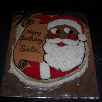 Santa Claus Santa cake using a Wilton character pan. Persons birthday was at Christmas, so wrote the message on the scroll