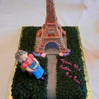 Birthday Cake With Eiffel Tower Birthday cake for 90 year old aunt who lived many years in Paris. She is also a Bible scholar. The little lady in the chair is reading the...