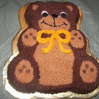 Teddy Bear Bear cake made with Wilton character pan. First cake using star tip.
