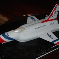 Groom's Cake - 3D Air Force Thunderbird   Cake sculpted to resemble an Air Force Thunderbird. Wings are made of gumpaste.