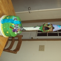 Tangled Cake   I used a papertowel roll with a dowel rod in it for the tower. I used a plastic pop bottle for the house.